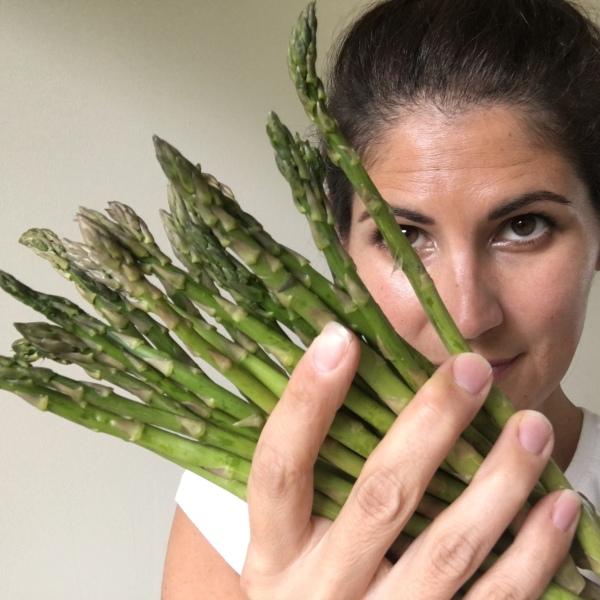 Woman holding Asparagus