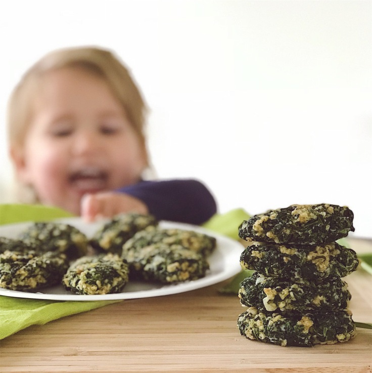 Photo of child reaching for spinach bites