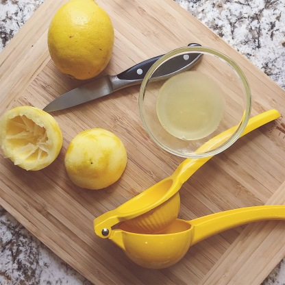 Photo of a lemon being juiced